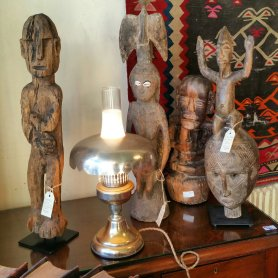 Introducing from left to right. Guardian figure East Timor $695. Female  figure PNG rare owl on reverse. Another later PNG carving of a  man.  And lastly Dogon mask. From Africa to bring rain prior to harvest.